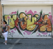 Woman Matches Graffiti on Garage