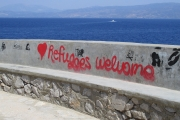 Hydra Islan d - Seawall with Refugees Welcome Sign