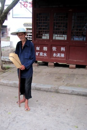 Old Man in the Street with Broom