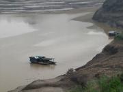 Three Sampans Near Shore