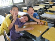 Three Boys in Rural Classroom